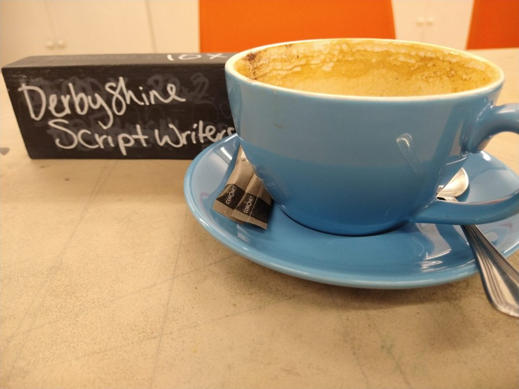 A cup of coffee at a table reserved for Derbyshire Scriptwriters